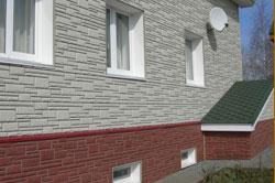 Искусственный камень в отделке загородного строения